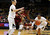 Stanford forward Chiney Ogwumike, center, reaches out for the loose ball as Colorado forward Jen Reese, left, and guard Ashley Wilson cover during the first half of an NCAA women's college basketball game in Boulder, Colo., on Friday, Jan. 4, 2013. (AP Photo/David Zalubowski)