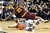 Arizona State's Evan Gordan (10) falls on Colorado's Jeremy Adams while going for a loose ball during the first half of an NCAA college basketball game on Saturday, Feb. 16, 2013, in Boulder, Colo. (AP Photo/Daily Camera, Cliff Grassmick)