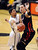 Askia Booker of CU shoots around Jason Washburn of Utah during the second half of the February 21st, 2013 game in Boulder.