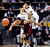 An inbounds pass gets over Askia Booker, top, of Colorado, and Brandon Taylor of Utah during the first half of the February 21st, 2013 game in Boulder.