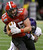 Louisiana-Lafayette tight end Ian Thompson (85) is taken down by East Carolina linebacker Gabriel Woullard (42) in the first half of the New Orleans Bowl, an NCAA college football game in New Orleans, Saturday, Dec. 22, 2012. (AP Photo/Bill Haber)