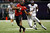 Terrance Broadway #8 of the Louisiana-Lafayette Ragin Cajuns is tackled by Damon Magazu #11 of the East Carolina Pirates during the R+L Carriers New Orleans Bow at the Mercedes-Benz Superdome on December 22, 2012 in New Orleans, Louisiana.  (Photo by Chris Graythen/Getty Images)