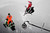 ASPEN, CO - January 26: Levi LaVallee, right, raises his hand in victory while going over the final jump with Cory Davis, left, during the Snowmobile Speed & Style event at Winter X Games Aspen 2013 at Buttermilk Mountain on Jan. 26, 2013, in Aspen, Colorado. LaVallee won gold and Davis won silver in the event. (Photo by Daniel Petty/The Denver Post)