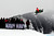 ASPEN, CO - January 26: Cory Davis goes off a jump as spectators look on during the Snowmobile Speed & Style event at Winter X Games Aspen 2013 at Buttermilk Mountain on Jan. 26, 2013, in Aspen, Colorado. Davis won silver in the event. (Photo by Daniel Petty/The Denver Post)