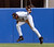 BERNIE WILLIAMS -- New York Yankees Bernie Williams fields a hit from Tampa Bay Devil Rays Bubba Trammell  during the fifth inning at Yankee Stadium in New York on July 23, 2000. (AP Photo/Ed Betz)