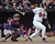 RAFAEL PALMEIRO -- Baltimore Orioles Rafael Palmeiro strokes the game-winning hit in the 10th inning as Cleveland Indians catcher Sandy Alomar watches on April 10, 1996 at Camden Yards.  (AP Photo/Dave Hammond)