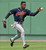 KENNY LOFTON -- Cleveland Indians center fielder Kenny Lofton grabs the ball with his bare hand preventing Boston Red Sox' Mike Macfarlane from  stretching a single into a double in the fourth inning at Fenway Park in Boston on May 21, 1995.      (AP Photo/Jim Rogash)