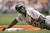 RONDELL WHITE -- Rondell White #24 of the Detroit Tigers hangs onto the bag as he advanced to third base on a first-inning sacrifice fly by Carlos Guillen as the Philadelphia Phillies defeated the Tigers 6-2 during MLB interleague action at the Citizens Bank Park on June 17, 2004 in Philadelphia, Pennsylvania. (Photo by Doug Pensinger/Getty Images)