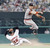 ALAN TRAMMELL -- Detroit Tigers' shortstop Alan Trammell turns the double play over the sliding Orioles Phil Bradley in the third inning of their game on July 1, 1989 at Memorial Stadium, Baltimore. (AP Photo/Jason Lee)