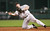 JEFF BAGWELL -- Houston Astros first baseman Jeff Bagwell throws to first base from his knees after fielding a hit by Atlanta Braves'  Rafael Furcal during the third inning on Aug. 5, 2004, in Houston.    (AP Photo/David J. Phillip)