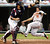 JEFF CONINE -- Baltimore Orioles' Jeff Conine (19) scores on Ramon Hernandez's two-run single as Cleveland Indians catcher Kelly Shoppach waits for the ball in the fourth inning of a baseball game on  July 8, 2006, in Cleveland. (AP Photo/Tony Dejak)
