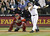 EDGAR MARTINEZ -- All eyes are on a long foul ball hit by Seattle Mariners designated hitter Edgar Martinez on Sept. 15, 2004, during a game against the Anaheim Angels at Safeco Field in Seattle as Angels catcher Bengie Molina and home-plate umpire Greg Gibson look on.   (AP Photo/Ted S. Warren)