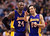 Los Angeles Lakers guards Kobe Bryant, right, and Steve Nash, right, talk during a time-out while playing against the Toronto Raptors during first half NBA basketball action in Toronto on Sunday Jan. 20, 2013. (AP Photo/THE CANADIAN PRESS,Nathan Denette)