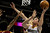 Denver Nuggets' Danilo Gallinari, right, lays one up over Cleveland Cavaliers' C.J. Miles, left, during the second quarter of an NBA basketball game Friday, Jan. 11, 2013, in Denver. (AP Photo/Barry Gutierrez)