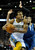 Denver forward Andre Iguodala (9) made a move past Wolves defender Alexey Shved in the second half. The Minnesota Timberwolves took a bite out of the Denver Nuggets winning 101-97 at the Pepsi Center Thursday night, January 3, 2013. Karl Gehring/The Denver Post