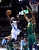 Denver Nuggets guard Ty Lawson (3) goes up for a shot against Utah Jazz forward Derrick Favors (15) during the second quarter of an NBA basketball game on Saturday, Jan. 5, 2013, in Denver. (AP Photo/Jack Dempsey)
