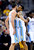 Denver Nuggets forward Danilo Gallinari, left, from Italy, chest-bumps teammate Andre Iguodala during the third quarter of an NBA basketball game against the Utah Jazz,  Saturday, Jan. 5, 2013, in Denver. (AP Photo/Jack Dempsey)