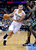 Denver Nuggets forward Danilo Gallinari (8) from Italy drives past Utah Jazz forward Marvin Williams (2) during an NBA basketball game Saturday, Jan. 5, 2013, in Denver. Denver defeated Utah 110-91.  (AP Photo/Jack Dempsey)