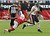 Matt Forte' #22 of the Chicago Bears runs past a diving Patrick Peterson #21 of the Arizona Cardinals at University of Phoenix Stadium on December 23, 2012 in Glendale, Arizona.  (Photo by Norm Hall/Getty Images)