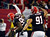 Atlanta Falcons defensive tackle Jonathan Babineaux (95) walks off the field with defensive tackle Corey Peters (91) after intercepting a pass from New Orleans Saints quarterback Drew Brees during the second half of an NFL football game, Thursday, Nov. 29, 2012, in Atlanta. The Falcons won 23-13. (AP Photo/Rich Addicks)