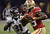 Bernard Pollard (L) of the Baltimore Ravens eyes Vernon Davis (R) of the San Francisco 49ers during Super Bowl XLVII at the Mercedes-Benz Superdome on February 3, 2013 in New Orleans, Louisiana.     TIMOTHY A. CLARY/AFP/Getty Images