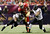 San Francisco 49ers tight end Vernon Davis (85) is tackled by Baltimore Ravens inside linebacker Ray Lewis (52) and outside linebacker Courtney Upshaw (91) during the second quarter in the NFL Super Bowl XLVII football game in New Orleans, Louisiana, February 3, 2013. REUTERS/Lucy Nicholson