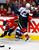 Calgary Flames' Lee Stempniak (L) goes flying after being hit by Colorado Avalanche' Jamie McGinn during the third period of their NHL hockey game in Calgary, Alberta, January 31, 2013. REUTERS/Todd Korol