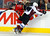 Calgary Flames' Mike Cammalleri (L) gets hit against the boards by Colorado Avalanche' Mark Olver during the second period of their NHL hockey game in Calgary, Alberta, January 31, 2013. REUTERS/Todd Korol