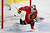 The puck goes past Calgary Flames' goalie Miikka Kiprusoff for a goal by Colorado Avalanche' PA Parenteau (not seen) during the second period of their NHL hockey game in Calgary, Alberta, January 31, 2013. REUTERS/Todd Korol