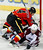 Calgary Flames' Jay Bouwmeester (L) knocks Colorado Avalanche' Matt Duchene to the ice during the first period of their NHL hockey game in Calgary, Alberta, January 31, 2013. REUTERS/Todd Korol