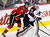 Calgary Flames' Blair Jones (L) runs into Colorado Avalanche goalie Jean-Sebastien Giguere during the first period of their NHL hockey game in Calgary, Alberta, January 31, 2013. REUTERS/Todd Korol
