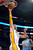 Los Angeles Lakers forward Pau Gasol, of Spain, dunks as Denver Nuggets forward Kenneth Faried looks on during the first half of their NBA basketball game, Sunday, Jan. 6, 2013, in Los Angeles. (AP Photo/Mark J. Terrill)