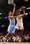 Metta World Peace #15 of the Los Angeles Lakers shoots over Andre Miller #24 of the Denver Nuggets at Staples Center on January 6, 2013 in Los Angeles, California.   (Photo by Stephen Dunn/Getty Images)