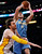 Denver Nuggets' Danilo Gallinari of Italy goes to the basket above Los Angeles Lakers' Pau Gasol (L) of Spain during the first half of their NBA basketball game in Los Angeles January 6, 2013. REUTERS/Danny Moloshok