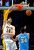 Los Angeles Lakers forward Pau Gasol, left, of Spain, dunks as Denver Nuggets center JaVale McGee defends dunks during the first half of their NBA basketball game, Sunday, Jan. 6, 2013, in Los Angeles.  (AP Photo/Mark J. Terrill)