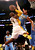 Kobe Bryant #24 of the Los Angeles Lakers goes up for a shot against JaVale McGee #34 of the Denver Nuggets at Staples Center on January 6, 2013 in Los Angeles, California.   (Photo by Stephen Dunn/Getty Images)