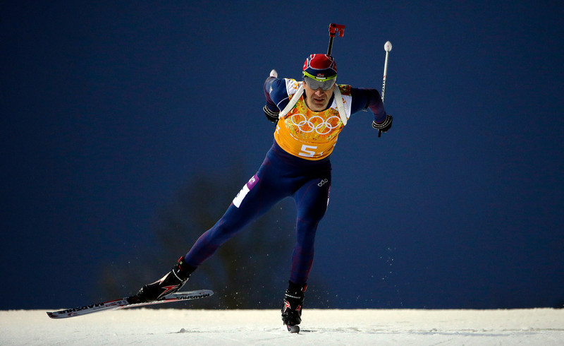 Description of . Norway's Ole Einar Bjoerndalen competes during the men's biathlon 4x7.5K relay at the 2014 Winter Olympics, Saturday, Feb. 22, 2014, in Krasnaya Polyana, Russia. (AP Photo/Felipe Dana)