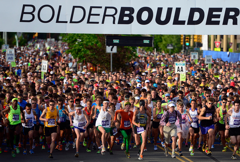 The first wave of runners takes off from the starting line with over 50,000 racers registering this year. The 36th BolderBoulder takes place on the streets of Boulder, CO on Memorial Day, May 26, 2014. The 10K event brings winds through the streets of Boulder and finishes at Folsom Field on the University of Colorado campus. (Kathryn Scott Osler, The Denver Post)