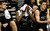 Akron Zips forward Nick Harney covers his face with a towel as he sits on the bench during the final minutes of the second half of their second round NCAA tournament basketball game against the VCU Rams in Auburn Hills, Michigan March 21, 2013.  REUTERS/ Rebecca Cook