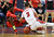 DENVER, CO. - MARCH 08: TreShawn Wilford #2 of Eaglecrest High School, left, and Josh Perkins #3 of Regis High School are fighting for the control of free ball during 5A State quarter final game at Denver Coliseum. March 8, 2013. Denver, Colorado. Eaglecrest won 64-57. (Photo By Hyoung Chang/The Denver Post)