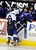 DENVER, CO. - FEBRUARY 28: Mustangs forward Kyle Valdez (16) put Cougars forward Tad Strohauer (52) back into his own bench on a check in the first period. Ralston Valley High School took on Resurrection Christian Thursday night, February 28, 2013 in a semifinal match in the Colorado State Ice Hockey Championships at Magness Arena in Denver. (Photo By Karl Gehring/The Denver Post)