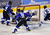 DENVER, CO. - FEBRUARY 28: Cougars goalie Brandan Alcorn (55) deflected a puck away from the net early in the first period as Mustangs' forward Matt Morelli (6) looked for a rebound. Ralston Valley High School took on Resurrection Christian Thursday night, February 28, 2013 in a semifinal match in the Colorado State Ice Hockey Championships at Magness Arena in Denver. (Photo By Karl Gehring/The Denver Post)