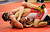 ARVADA, CO - JANUARY 19: Thompson Valley High School wrestler Trenton Parker, left, wrapped himself around opponent Ray MiJares of Brighton, right,  in a bout that decided third place. Parker defeated MiJares. The Arvada West High School wrestling tournament wrapped up Saturday night, January 19, 2013. Karl Gehring/The Denver Post