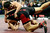 DENVER, CO - FEBRUARY 23: Keaton Sameshima earns a third period fall against Paonia's Tony Darling in the class 2A 285-pound final during the Colorado State High School Wrestling Championships. The state's top wrestlers squared off in four classes in front of a near-capacity crowd at the Pepsi Center. (Photo by AAron Ontiveroz/The Denver Post)