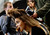 A model eats a piece of chicken as her hair is styled backstage before the Herve Leger By Max Azria Autumn/Winter 2013 collection runway show during New York Fashion Week February 9, 2013. REUTERS/Joshua Lott