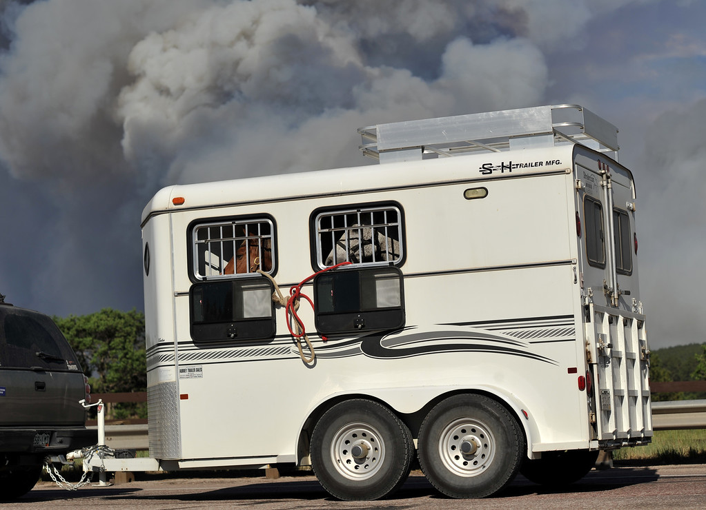 Description of . Colorado Springs, CO. - June 11: Evacuees are leaving the smoke covered BLack Forest area. Colorado Springs, Colorado. June 11, 2013. The fire is about 15 acres near the 12600 block of Peregrine Way near Black Forest Regional Park. (Photo By Hyoung Chang/The Denver Post)