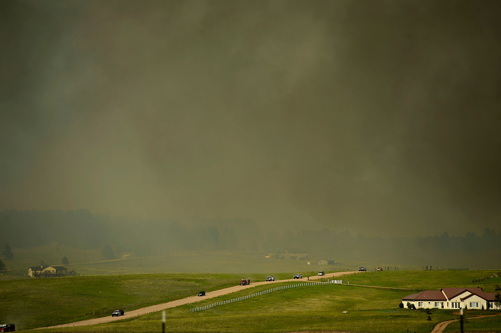 Description of . COLORADO SPRINGS, CO. - June 12: Residents and emergency personal evacuating as the Black Forest Fire moves towards Walker Road. Colorado Springs, Colorado. June 12, 2013 Denver, Colorado Springs. (Photo By Joe Amon/The Denver Post)