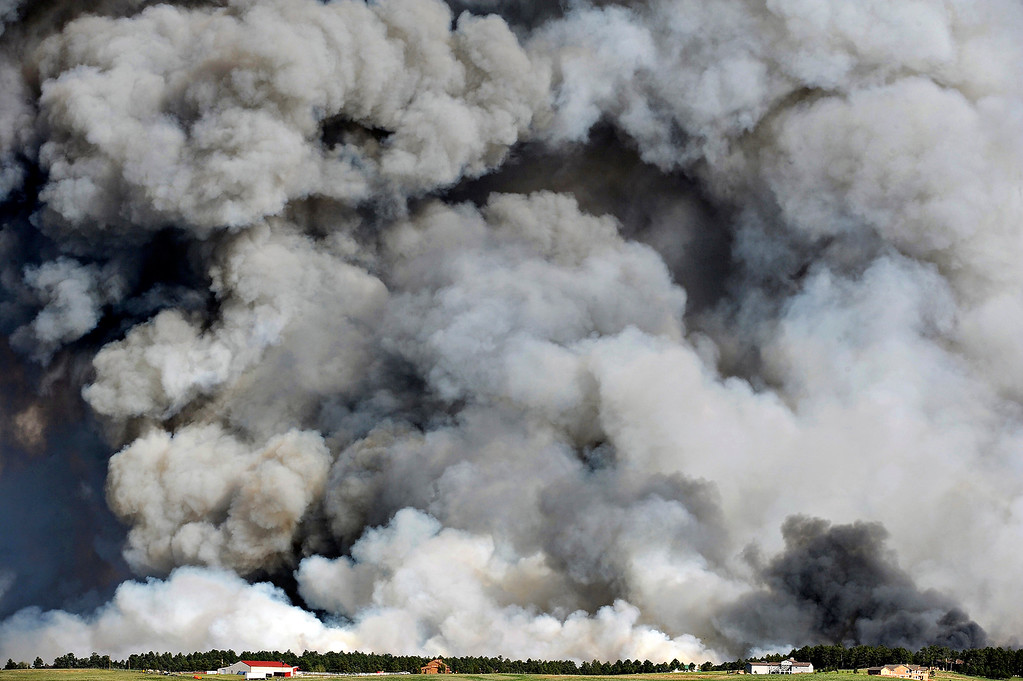 Description of . A wall of smoke looms large over the horizon as the Black Forest fire destroys the landscape south of Mountain Dance Drive and Open Sky Way, which is northeast of Colorado Springs, on June 11, 2013. The Black Forest fire started around 1:45pm that day.