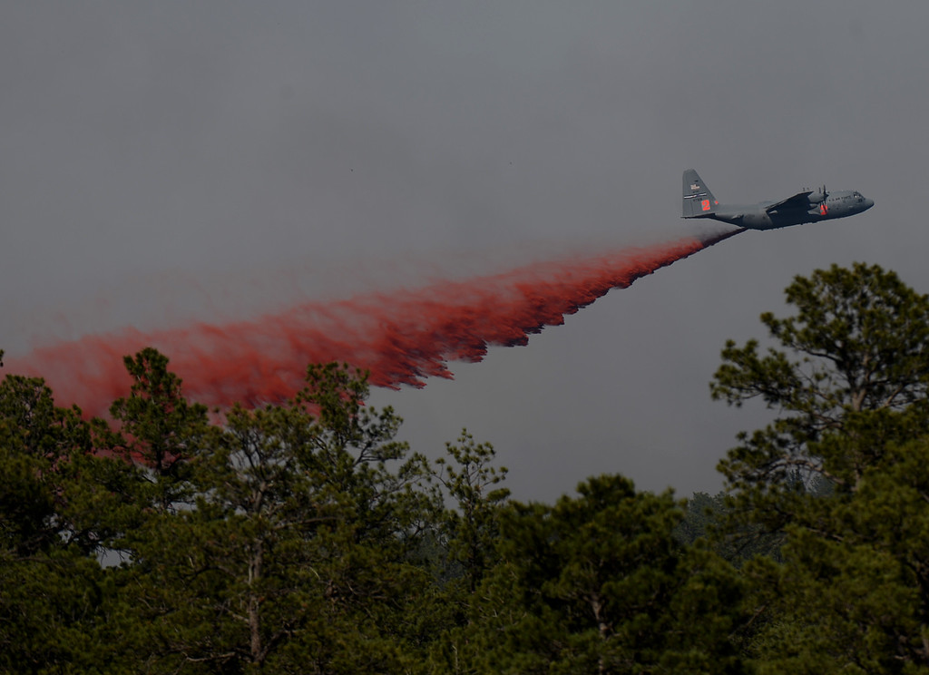 Description of . COLORADO SPRINGS, CO. - June 12:  A slurry bomber fights the Black Forest Fire. Colorado Springs, Colorado. June 12, 2013. According to El Paso County Sheriff Terry Maketa, the Black Forest Fire north of Colorado Springs has already burned 80 to 100 homes. (Photo By Hyoung Chang/The Denver Post)