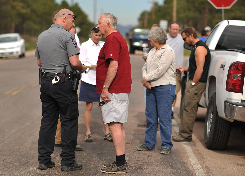 Description of . Walt Hessler, front right, and evacuees of Black Forest fire are waiting El Paso County Sheriff\'s escort to their property at the corner of Vollmer Rd. and Burgess Rd. Colorado Springs, Colorado. June 14, 2013.  (Photo By Hyoung Chang/The Denver Post)